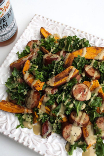 Tahini Kale Salad with Chicken Sausage and Sweet Potato Fries