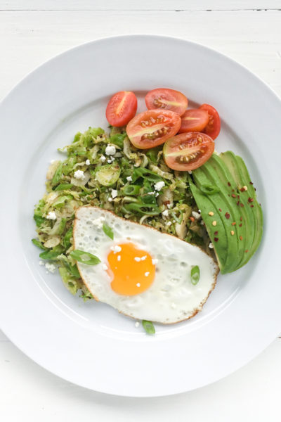 Shredded & Fried Buttery Brussels Topped With An Egg + Avocado