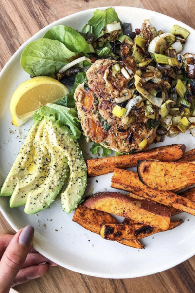 Turkey Burgers Topped with Sautéed Leeks and Sweet Potato Fries